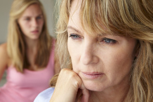 Unhappy mother with teenage girl